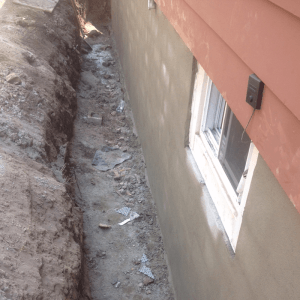 Completed foundation wall repair prior to waterproofing