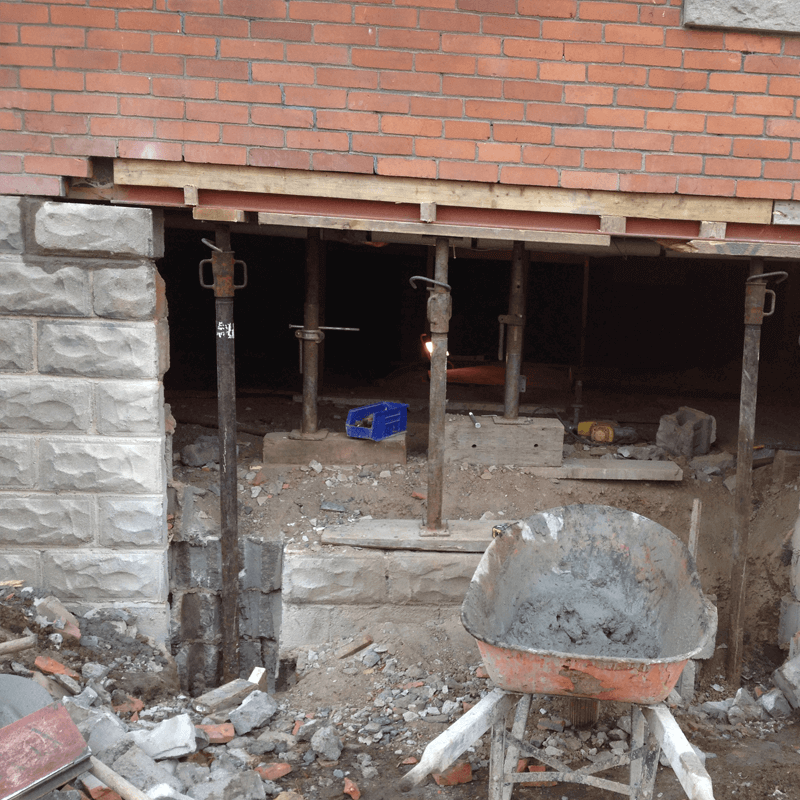 Supporting wall during foundation rebuild